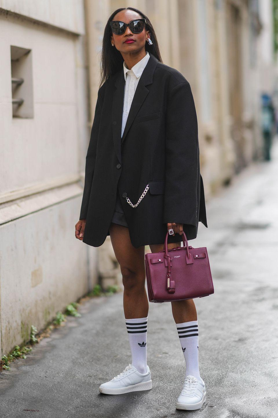 <p>We love this preppy look seen outside the Off-White show, with pulled-up socks and a buttoned-up shirt. Give it a go by adding a sporty touch to your polished look.</p>