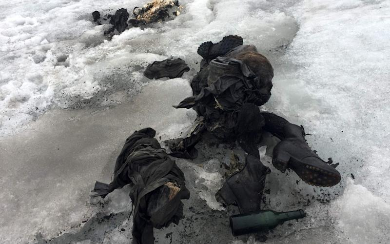 The mummified remains of a Swiss Couple (Marcelin and Francine Dumoulin) who went missing 75 years ago and who were found in a glacier in the Diablerets mountains, in southern Switzerland. The perfectly preserved bodies lay close to each other, with at their side backpacks, a bottle, a book and a watch. - AFP