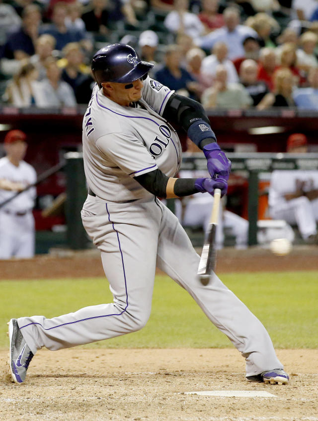 Colorado Rockies' Troy Tulowitzki connects for a two-run home run against the Arizona Diamondbacks during the sixth inning of a baseball game on Tuesday, April 29, 2014, in Phoenix. (AP Photo/Ross D. Franklin)
