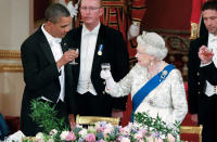 FILE - In this May 24, 2011, file photo Queen Elizabeth II, and U.S. President Barack Obama attend a state banquet in Buckingham Palace, London. (AP Photo/Lewis Whyld, Pool, File)