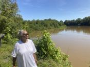 Reatha Jefferson looks out over the Great Pee Dee River on Monday, Aug. 17, 2020, Pamplico, SC. Dominion plans to build a new 14.5-mile-long gas line along the river and cites new energy demand spurred by economic growth in eastern South Carolina as the impetus for the project. Jefferson is one of several landowners protesting the pipeline because they are worried about its potential environmental effects. (AP Photo/Michelle Liu)