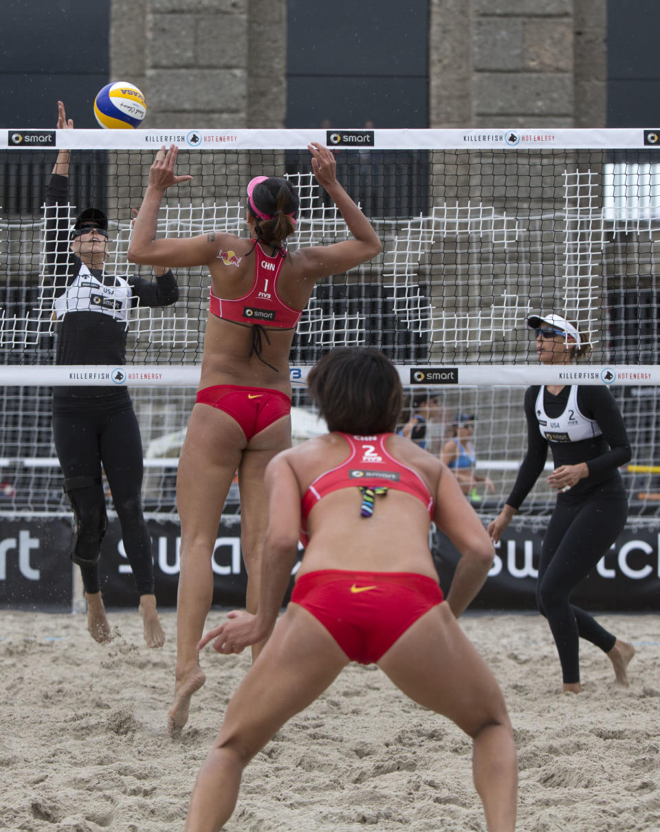 China's Xi Zhang (2nd R) and her teammate Chen Xue (2nd L) vie for the ball with Brooke Hanson (L) and Lauren Fendrick (R) of the US during their FIVB Beach-Volleyball Grand Slam 2012 match in Berlin on July 12, 2012. The team of China won the match 21-14, 21-19. The Grand slam takes place from July 10 to 15, 2012. AFP PHOTO / DAVID GANNONDAVID GANNON/AFP/GettyImages