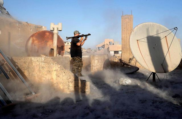 <p>An American volunteer fighter of Syrian Democratic Forces fires an RPG during a battle with Islamic State militants at the frontline in Raqqa, Syria, Oct. 6, 2017. (Photo: Erik De Castro/Reuters) </p>
