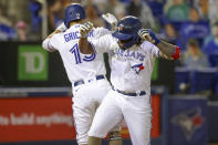 Toronto Blue Jays' Vladimir Guerrero Jr., right, celebrates his solo home run against the Philadelphia Phillies with Randal Grichuk during the sixth inning of a baseball game Friday, May 14, 2021, in Dunedin, Fla. (AP Photo/Mike Carlson)