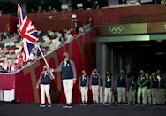 <p>Great Britain went casual with white trousers and red, white and blue striped sweat jackets.</p>