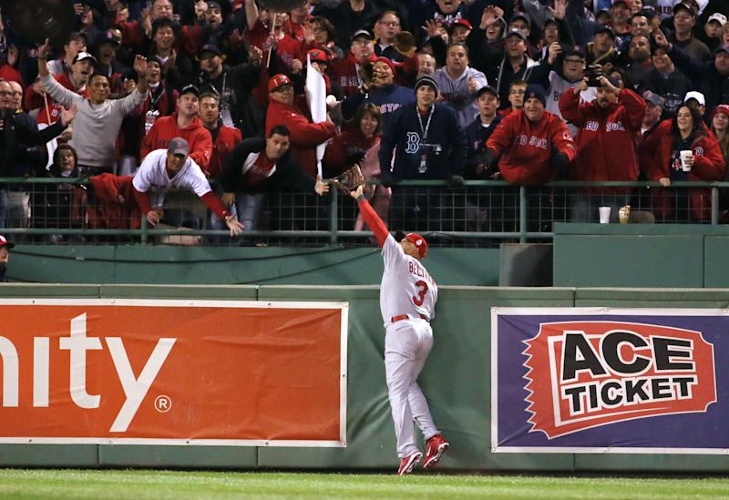 St. Louis Cardinals right fielder Carlos Beltran catches a potential grand slam by Red Sox designated hitter David Ortiz in the second inning during Game 1 of the World Series between the St. Louis Cardinals and the Boston Red Sox on Wednesday, Oct. 23, 2013, at Fenway Park in Boston. A run scored on the sacrifice fly. Beltran later left the game with a right rib contusion. (AP Photo/St. Louis Post-Dispatch, Chris Lee)