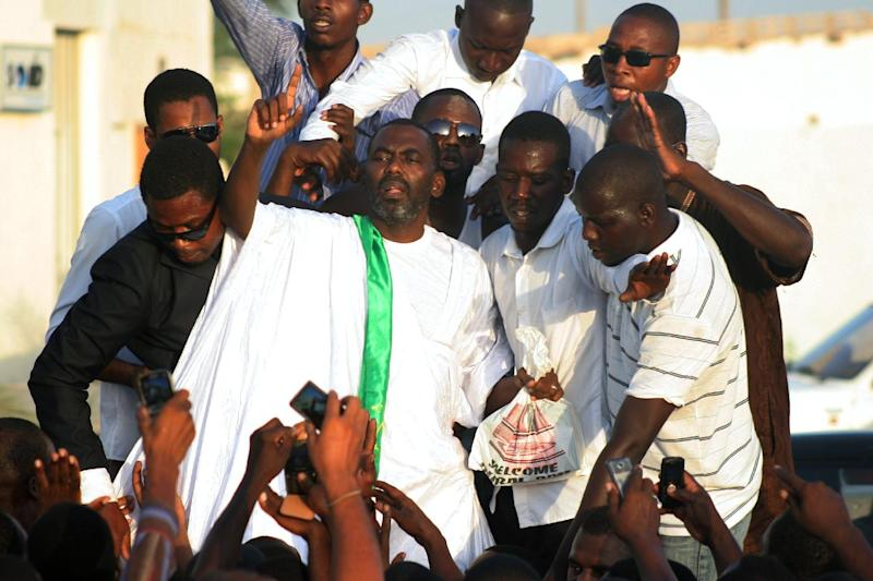 """Anti-slavery campaigner Ould Abeid (C), head of the """"Initiative for the Resurgence of the Abolitionist movement in Mauritania"""", speaks in Nouakchott on September 3, 2012"""