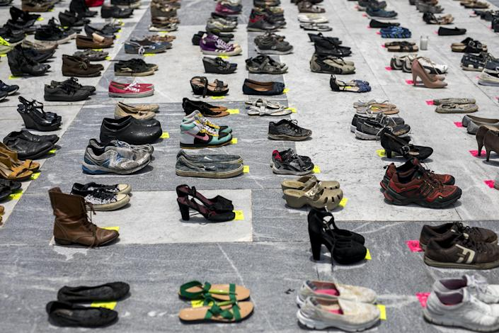 Empty pairs of shoes sit outside the Capitol building in San Juan, Puerto Rico, during a June 1, 2018, protest against the government's reporting of the death toll from Hurricane Maria.  (Photo: Bloomberg via Getty Images)