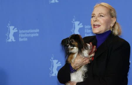 """U.S actress Lauren Bacall poses with her dog Sophie during a photocall to present her film """"The Walker"""" at the 57th Berlinale International Film Festival in Berlin in this file picture taken February 13, 2007. REUTERS/Arnd Wiegmann/Files"""