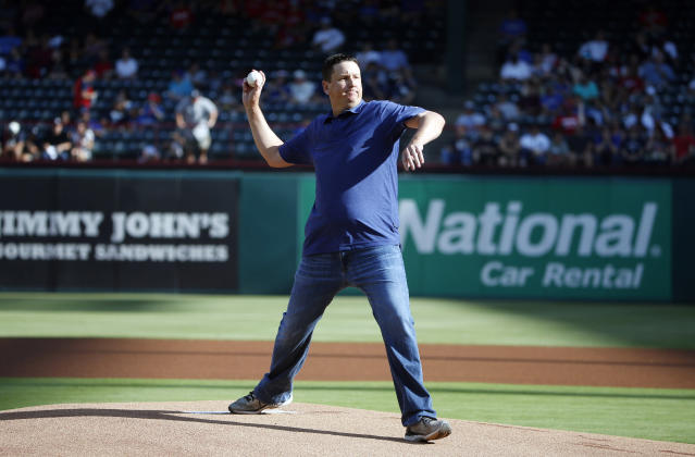 <p>PGA golfer JJ Henry throws out the first pitch a baseball game between the New York Yankees and Texas Rangers, Wednesday, May 23, 2018, in Arlington, Texas. (AP Photo/Michael Ainsworth) </p>
