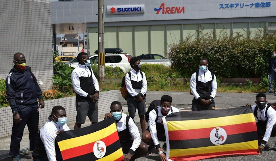 Members of the Uganda Olympics team pose for a photo call as they arrive at a hotel in Izumisano city, Osaka. Photo: AFP