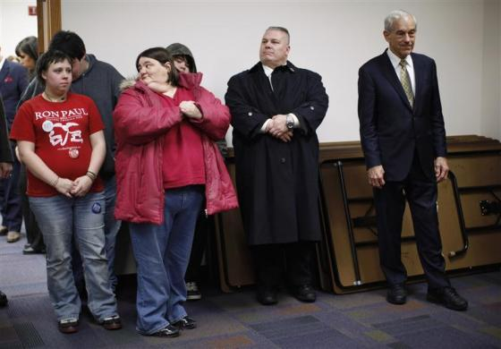 Ron Paul stands as he listens to his introduction at a Town Hall meeting at the Ericson Public Library during a campaign stop in Boone, Iowa December 8, 2011. (REUTERS/Jim Young)