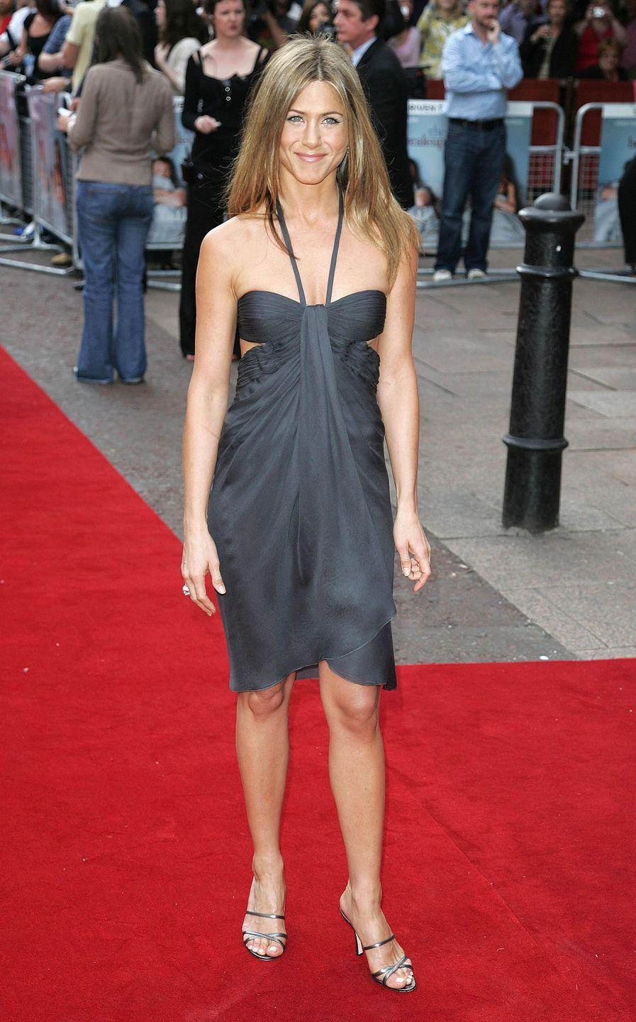 """<p>Jen rocked this halter top to the 2006 premiere of <em>The Break-Up</em>. Vince Vaughn and Jen star as a couple who lives together despite breaking up. It's possible Jen drew on her real-life experiences, but no one has looked better post-breakup. I mean, <a href=""""https://www.womenshealthmag.com/uk/fitness/a702389/how-to-look-as-hot-as-jennifer-aniston-hollywood-reporter/"""" rel=""""nofollow noopener"""" target=""""_blank"""" data-ylk=""""slk:look at those legs"""" class=""""link rapid-noclick-resp"""">look at those legs</a>.<br></p>"""