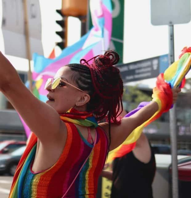 Claire Pearen protests on Whyte Avenue at 'Pride Corner.' (Submitted by Claire Pearen - image credit)