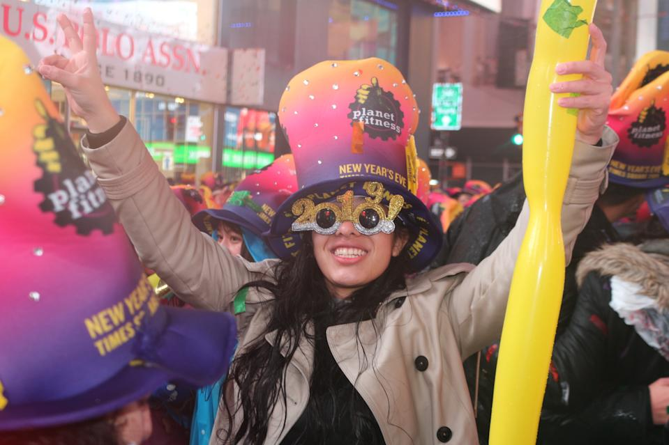 TIMES SQUARE, NEW YORK, UNITED STATES - 2019/01/01: A Participant seen wearing 2019 glasses during the New Year's Eve celebrations. Despite all day rain, More than 2 million people participate at the New Year's Eve celebrations at the Times Square. (Photo by Ryan Rahman/SOPA Images/LightRocket via Getty Images)
