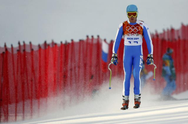 Italy's Innerhofer reacts after skiing out during the men's alpine skiing Super-G competition at the 2014 Sochi Winter Olympics