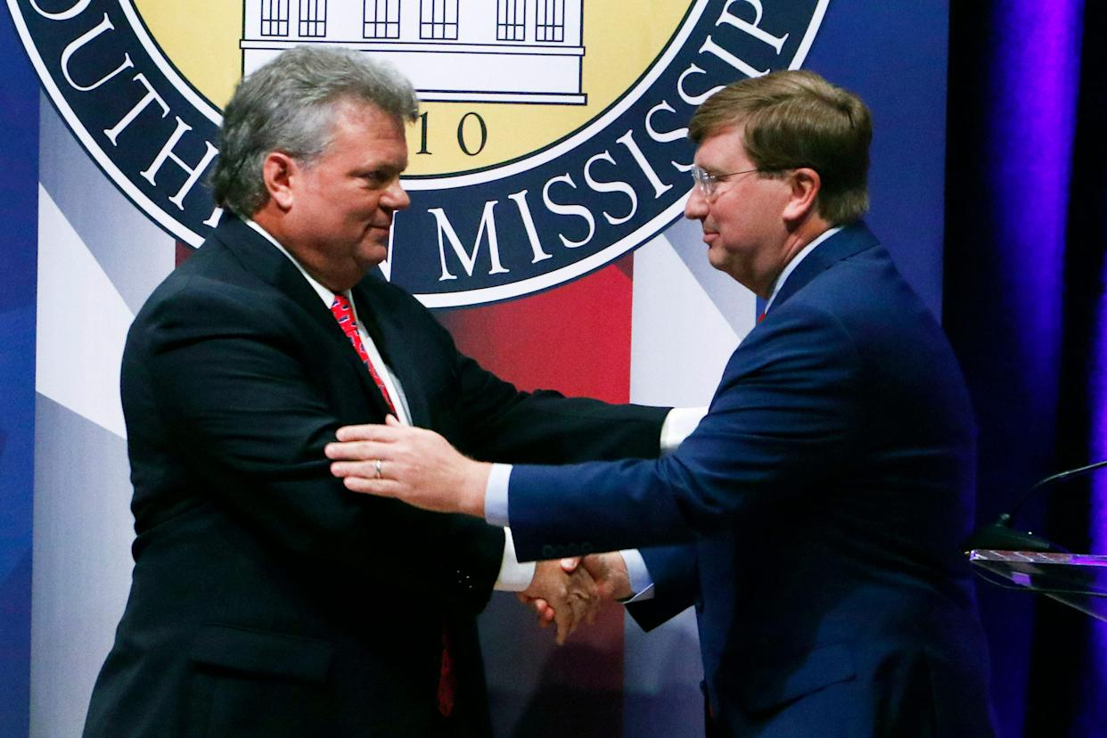 Democratic State Attorney General Jim Hood, left and Republican Lt. Gov. Tate Reeves, right, shake hands at the conclusion of their first televised gubernatorial debate at the University of Southern Mississippi in Hattiesburg, Miss., Thursday, Oct. 10, 2019.