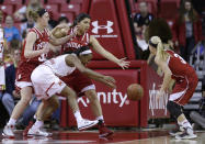 Maryland guard Shatori Walker-Kimbrough, second from left, chases after a loose ball as she is surrounded by Indiana forward Amanda Cahill, from left, forward Lyndsay Leikem and guard Tyra Buss in the first half of an NCAA college basketball game, Thursday, Feb. 26, 2015, in College Park, Md. (AP Photo/Patrick Semansky)