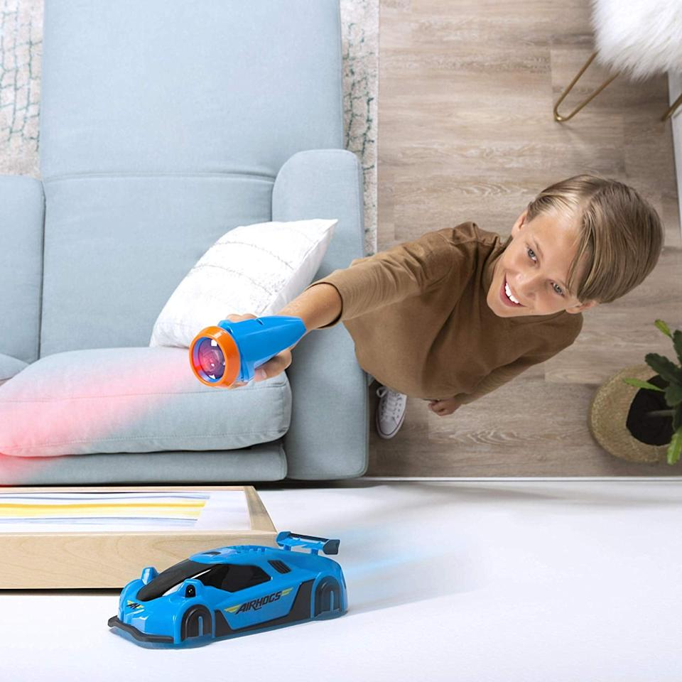 "<p>Ride the floors, walls, and ceiling with this awesome <a href=""https://www.popsugar.com/buy/Air-Hogs-Zero-Gravity-Laser-478926?p_name=Air%20Hogs%20Zero%20Gravity%20Laser&retailer=amazon.com&pid=478926&price=35&evar1=moms%3Aus&evar9=45804853&evar98=https%3A%2F%2Fwww.popsugar.com%2Ffamily%2Fphoto-gallery%2F45804853%2Fimage%2F46490342%2FAir-Hogs-Zero-Gravity-Laser&list1=gifts%2Ctoys%2Cgift%20guide%2Ctoy%20fair%2Cgifts%20for%20kids%2Ckids%20toys%2Cgifts%20for%20toddlers%2Cbest%20of%202019&prop13=api&pdata=1"" rel=""nofollow"" data-shoppable-link=""1"" target=""_blank"" class=""ga-track"" data-ga-category=""Related"" data-ga-label=""https://www.amazon.com/Air-Hogs-Gravity-Laser-Guided-Climbing/dp/B07NJHYXMD/"" data-ga-action=""In-Line Links"">Air Hogs Zero Gravity Laser</a> ($35), which is super lightweight and USB rechargeable.</p>"