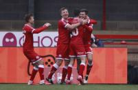 Crawley Town's Jordan Tunnicliffe, right, celebrates after scoring his side's third goal during the English FA Cup third round soccer match between Crawley Town and Leeds United at Broadfield Stadium in Crawley, England, Sunday, Jan. 10, 2021. (AP Photo/Ian Walton)