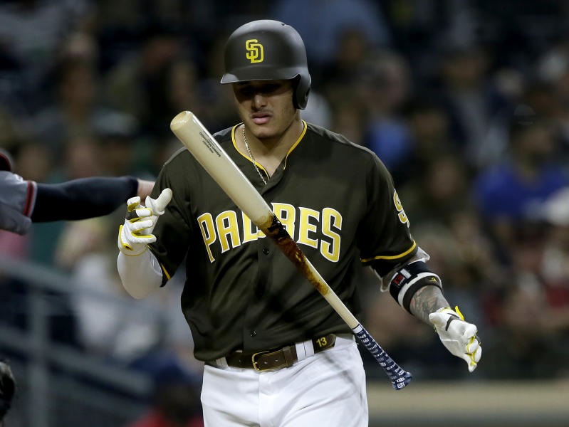 San Diego Padres' Manny Machado juggles his bat after striking out during the fourth inning of the team's baseball game against the Arizona Diamondbacks in San Diego, Friday, Sept. 20, 2019. (AP Photo/Alex Gallardo)
