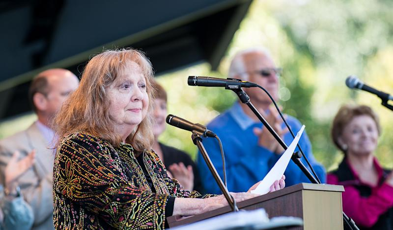 "In this photo provided by Hobart Jones, Actress Betty Lynn, who played Thelma Lou on ""The Andy Griffith Show,"" reads remarks from Rance Howard, father of film director Ron Howard, at the annual Mayberry Days celebration in Mount Airy, N.C. on Sunday, Sept. 30., 2012, This weekend's celebration was the first since the death of Griffith, who died July 3 at his home in Manteo, N.C. (AP Photo/Hobart Jones)"