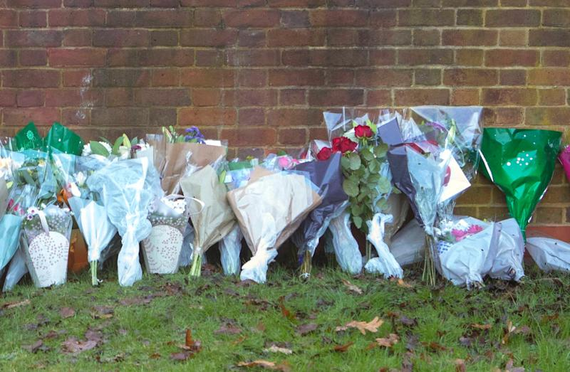 Flowers and tributes at the scene near Debden Park High School, in Loughton (PA)