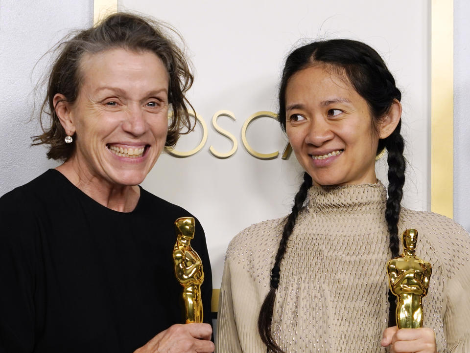 Frances McDormand and Chloe Zhao pose in the press room at the Oscars on Sunday, April 25, 2021. (Photo by Chris Pizzello-Pool/Getty Images)