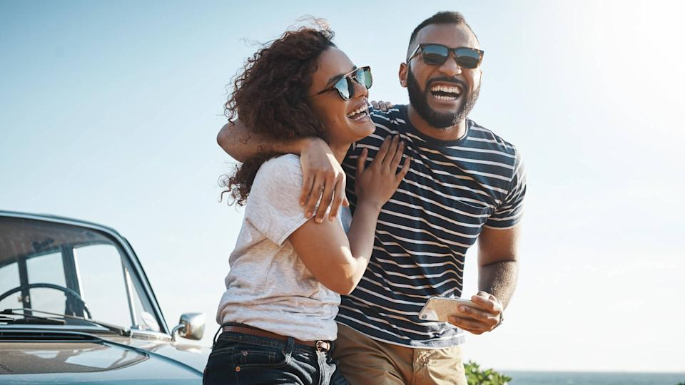 Shot of a young couple enjoying a summer?s road trip together.