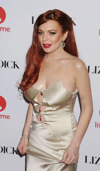 """Lohan is being given mixed reviews at best for her performance as Elizabeth Taylor in the Lifetime TV movie of the week. The <a href=""""http://www.hollywoodreporter.com/review/lindsay-lohan-liz-dick-tv-391316"""">Hollywood Reporter</a> says Lohan is """"woeful as Taylor from start to finish"""" while Newsday says Lohan's """"skills are rudimentary — made rustier by a long absence and a lot of other extracurricular activities."""" (Photo by Jason LaVeris/FilmMagic)"""