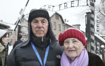 FILE - In this Monday, Jan. 26, 2015 file photo Rose Schindler, 85, right, a survivor of Auschwitz, and her husband Max, 85, visit the former death camp in Oswiecim, Poland. Schindler was among dozens of survivors who visited the site a day ahead of ceremonies marking the 70th anniversary of the camp's liberation by Soviet troops in 2015, but this year the 91-year-old is marking the sombre anniversary from her home in San Diego. Commemorations for this year's 76th anniversary will be mostly online due to the coronavirus pandemic. (AP Photo/Czarek Sokolowski, file)