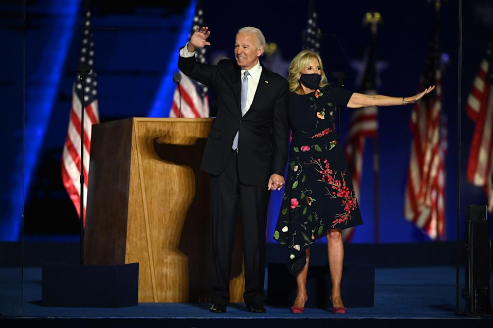 US President-elect Joe Biden stands with wife Jill Biden after delivering remarks in Wilmington, Delaware, on November 7, 2020, after being declared the winners of the presidential election. (Photo by Jim WATSON / AFP) (Photo by JIM WATSON/AFP via Getty Images)