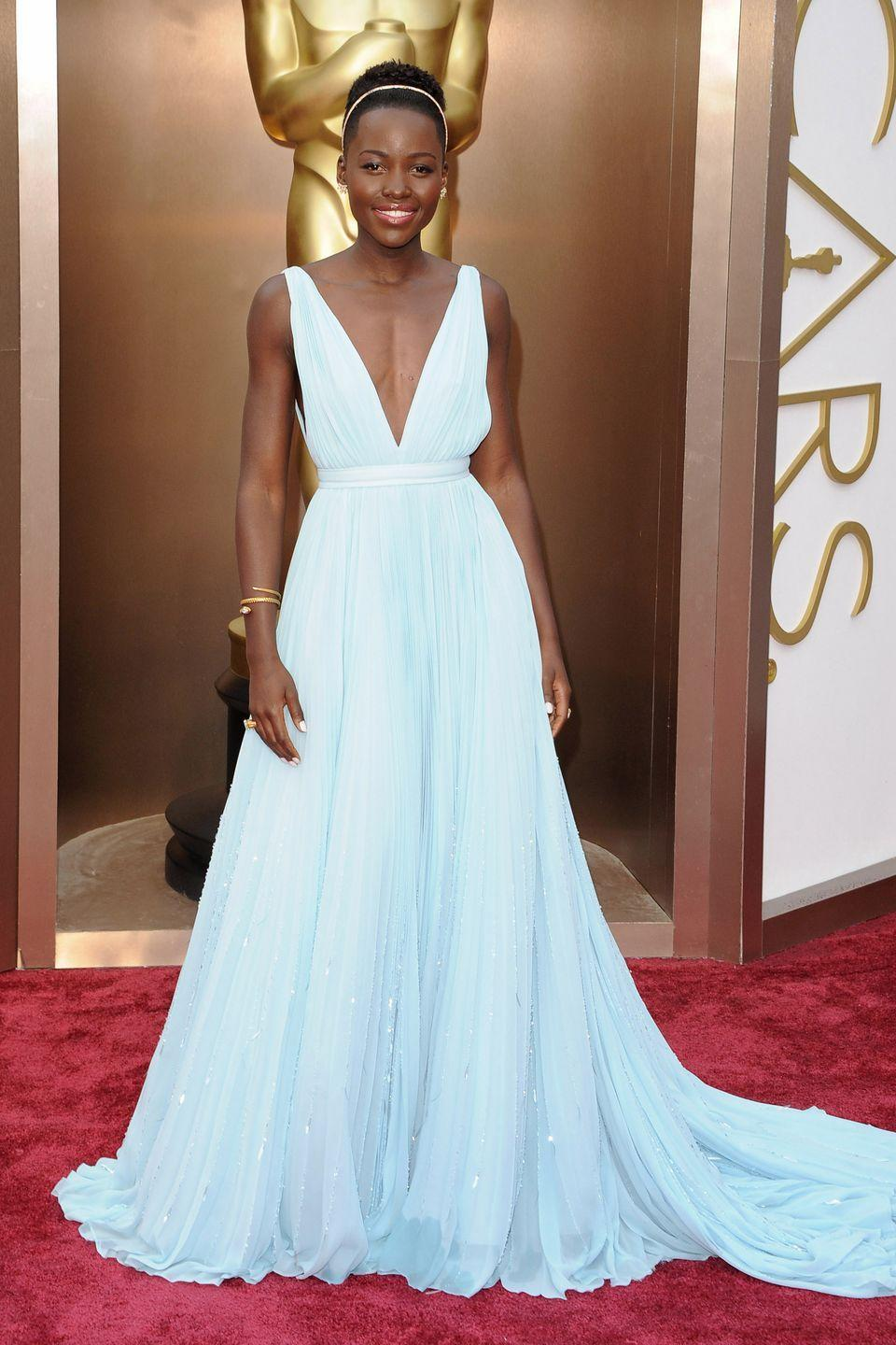 <p>Lupita Nyong'o wore a minimalist version of Cinderella's dress—designed by Prada—to the 86th Academy Awards in 2014, when she won the Oscar for Best Supporting Actress.</p>