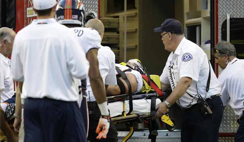 Injured Denver Broncos defensive end Derek Wolfe is carried to an ambulance after he was hurt on a play in the first half of a preseason NFL football game against the Seattle Seahawks, Saturday, Aug. 17, 2013, in Seattle. (AP Photo/Elaine Thompson)