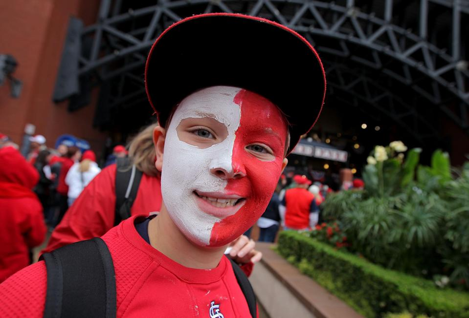 ST LOUIS, MO - OCTOBER 19: A young fan smiles before during Game One of the MLB World Series between the Texas Rangers and the St. Louis Cardinals at Busch Stadium on October 19, 2011 in St Louis, Missouri. (Photo by Doug Pensinger/Getty Images)