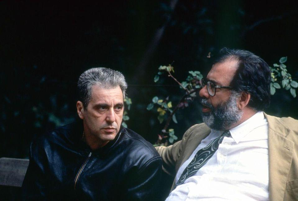 <p>After a long hiatus, Coppola and the other cast members returned for <em>The Godfather: Part III</em> in 1990. Here, Pacino and Coppola engage in a discussion off camera. </p>