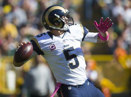 FILE PHOTO: Oct 11, 2015; Green Bay, WI, USA; St. Louis Rams quarterback Nick Foles (5) throws a pass during the second quarter against the Green Bay Packers at Lambeau Field. Mandatory Credit: Jeff Hanisch-USA TODAY Sports / Reuters Picture Supplied by Action Images