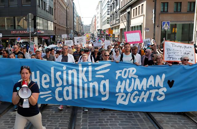 <p>People attend 'Helsinki Calling' protest ahead of meeting between the President Donald Trump and Russian President Vladimir Putin in Helsinki, Finland, July 15, 2018. (Photo: Grigory Dukor/Reuters) </p>