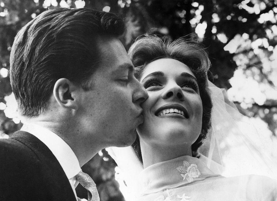 <p>Andrews and her first husband, British costume designer Tony Walton, pose for a photograph at their wedding in England. </p>