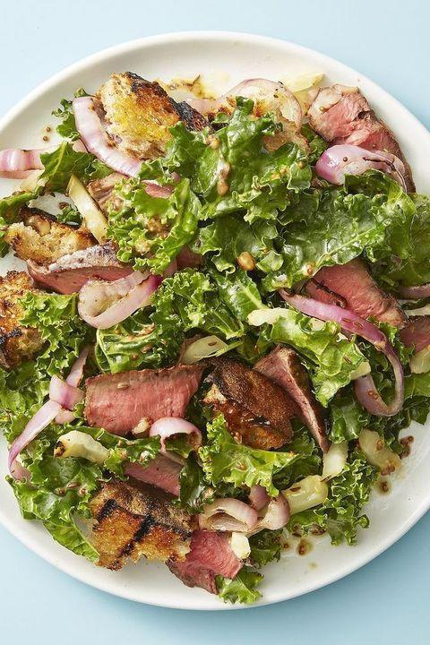 """<p>Like any great picnic salad, this one gets better as it sits. The crunchy grilled bread croutons soften slightly while the kale gets tender in the dressing.</p><p><em><a href=""""https://www.goodhousekeeping.com/food-recipes/easy/a28210682/steak-and-rye-panzanella-recipe/"""" rel=""""nofollow noopener"""" target=""""_blank"""" data-ylk=""""slk:Get the recipe for Steak and Rye Panzanella »"""" class=""""link rapid-noclick-resp"""">Get the recipe for Steak and Rye Panzanella »</a></em></p>"""