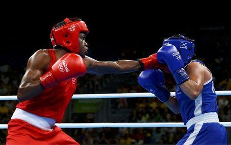 2016 Rio Olympics - Boxing - Final - Women's Fly (51kg) Final Bout 267 - Riocentro - Pavilion 6 - Rio de Janeiro, Brazil - 20/08/2016. Nicola Adams (GBR) of Britain and Sarah Ourahmoune (FRA) of France compete. REUTERS/Peter Cziborra