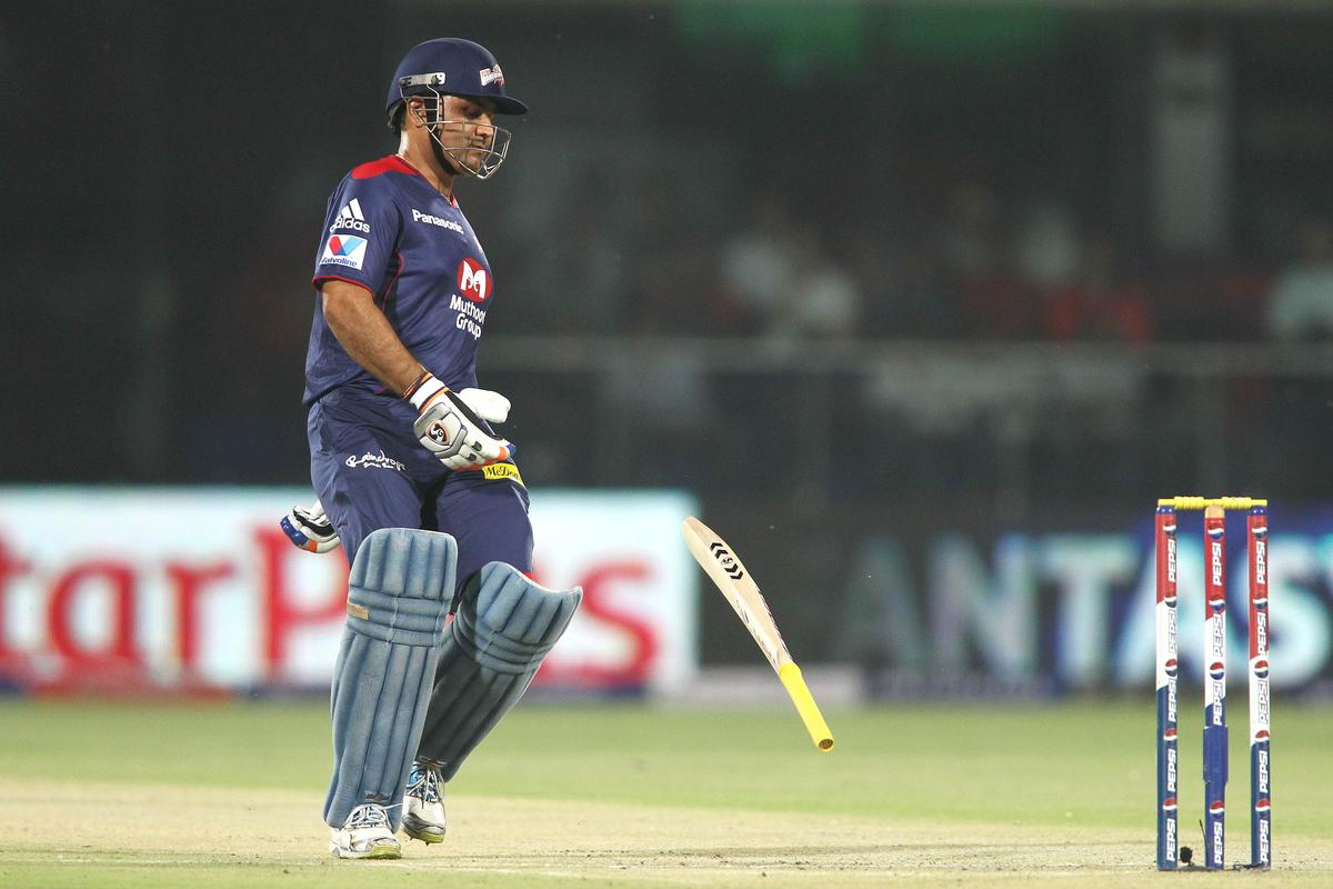 Virender Sehwag of Delhi Daredevils drops his bat while taking a run during match 14 of the Pepsi Indian Premier League between The Delhi Daredevils and the Sunrisers Hyderabad held at the Feroz Shah Kotla Stadium, Delhi on the 12th April 2013..Photo by Shaun Roy-IPL-SPORTZPICS ..Use of this image is subject to the terms and conditions as outlined by the BCCI. These terms can be found by following this link:..https://ec.yimg.com/ec?url=http%3a%2f%2fwww.sportzpics.co.za%2fimage%2fI0000SoRagM2cIEc&t=1493027225&sig=GxJ8ryxddolcrjFfOGmgKQ--~C