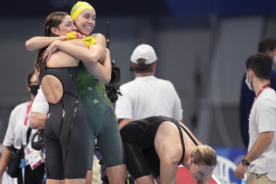 Australian women's 4x100m freestyle relay team celebrate after winning the gold medal at the 2020 Summer Olympics, Sunday, July 25, 2021, in Tokyo, Japan. (AP Photo/Matthias Schrader)