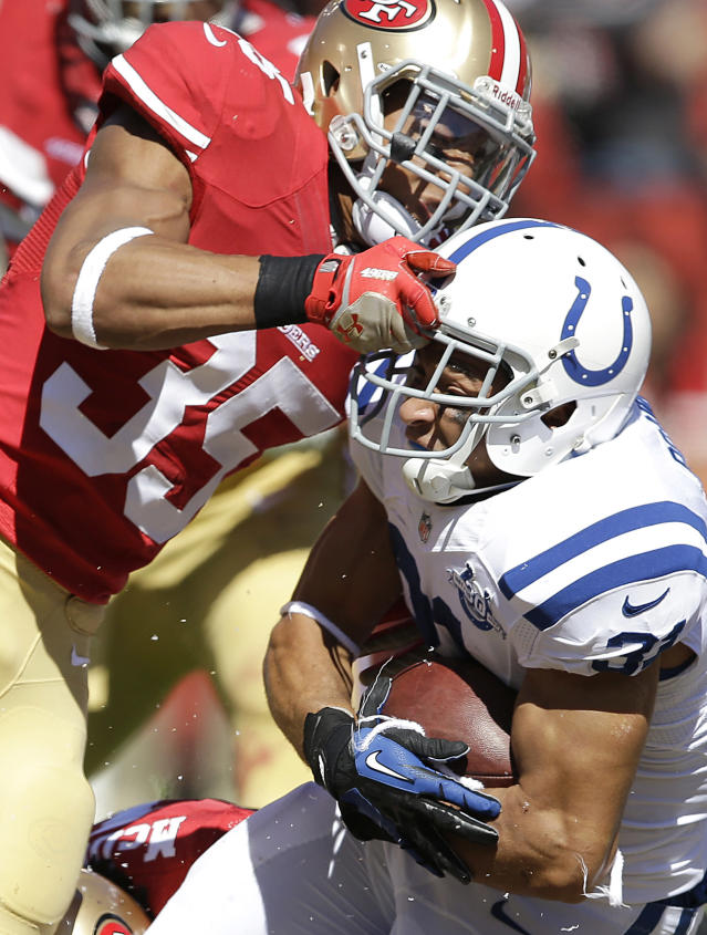 San Francisco 49ers safety Eric Reid (35) tackles Indianapolis Colts running back Donald Brown during the second quarter of an NFL football game, Sunday, Sept. 22, 2013, in San Francisco. (AP Photo/Aaron Kehoe)