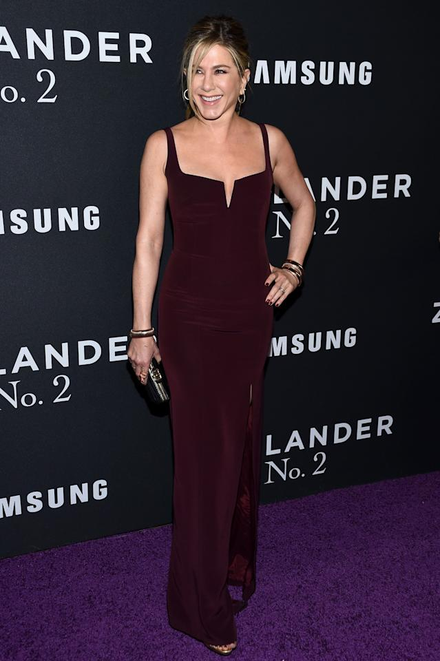 <p>Jennifer opted for a burgundy corset gown by Galvan for the premiere of <i>Zealander 2</i>. <i>[Photo: Getty]</i> </p>