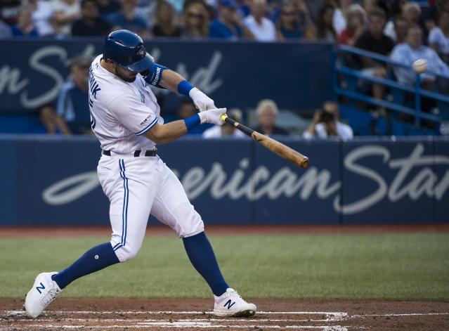 Toronto Blue Jays designated hitter Randal Grichuk hits a solo home run against the Texas Rangers during the second inning of a baseball game, Tuesday Aug. 13, 2019 in Toronto. (Nathan Denette/The Canadian Press via AP)