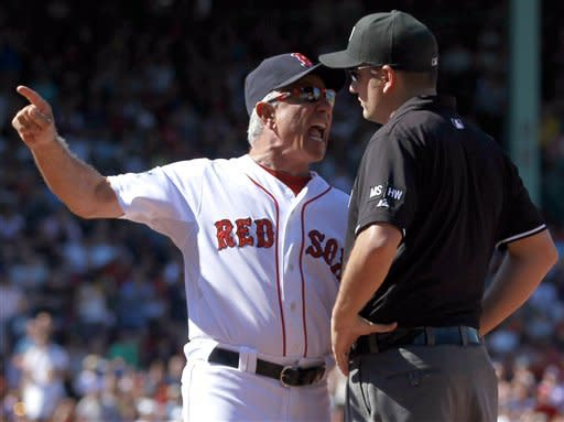 Boston Red Sox manager Bobby Valentine, left, argues a call with first base umpire Dan Bellino, right, after Red Sox's Dustin Pedroia was called out at first base in the fifth inning of a baseball game against the Kansas City Royals at Fenway Park in Boston, Sunday, Aug. 26, 2012. Valentine was thrown out of the game. (AP Photo/Steven Senne)