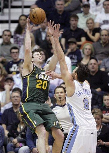 Utah Jazz guard Gordon Hayward (20) shoots as Denver Nuggets forward Danilo Gallinari (8) defends in the second quarter during an NBA basketball game Monday, Nov. 26, 2012, in Salt Lake City. (AP Photo/Rick Bowmer)