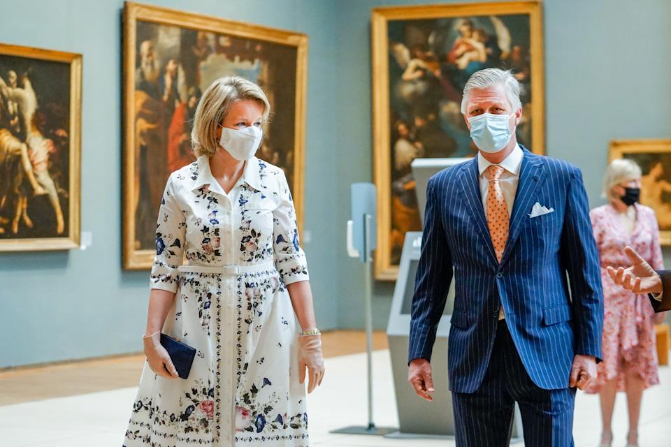 """BRUSSELS, BELGIUM - MAY 19: King Philippe of Belgium and Queen Mathilde of Belgium wearing Face Masks visit the Royal Museums of Fine Arts on May 19, 2020 in Brussels, Belgium. The Old Masters Museum covers a period from the 15th to the 18th century and opens its doors again after a 2-monthly period of closure due to the outbreak of COVID-19. With this visit the King and the Queen give their support to the severely affected cultural sector. The Belgian government asks all citizens to stay home and refrain from """"non-essential inbound and outbound travel"""" to slow the spread of the coronavirus.  9,108 people have died in Belgium from COVID-19. (Photo by Daïna Le Lardic /Royal Belgium Pool/Getty Images)"""
