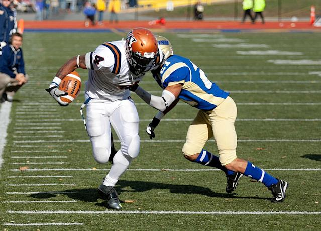 In this photo provided by Worcester State University, Western Connecticut State running back Octavias McKoy (4) runs the ball against Worcester State during an NCAA college Division III football game in Worcester, Mass., Saturday, Oct. 26, 2013. McKoy ran for 455 yards, setting an NCAA record for all-divisions, while defeating Worcester State 55-35 on Saturday. (AP Photo/Worcester State University, Matt Wright)
